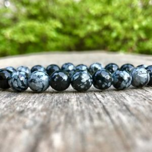Shop Snowflake Obsidian Bracelets! Faceted Snowflake Obsidian Bracelet 8mm Faceted Snowflake Obsidian Beaded Gemstone Bracelet Balancing Energy Bracelet Purity Bracelet | Natural genuine Snowflake Obsidian bracelets. Buy crystal jewelry, handmade handcrafted artisan jewelry for women.  Unique handmade gift ideas. #jewelry #beadedbracelets #beadedjewelry #gift #shopping #handmadejewelry #fashion #style #product #bracelets #affiliate #ad