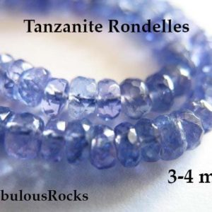 Shop Tanzanite Beads! 10-100 pcs / Tanzanite Rondelles Gemstone Beads, Luxe AAA, 3-4 mm, Faceted / Periwinkle Blue, bridal exotic gem december birthstone 34 | Natural genuine beads Tanzanite beads for beading and jewelry making.  #jewelry #beads #beadedjewelry #diyjewelry #jewelrymaking #beadstore #beading #affiliate #ad