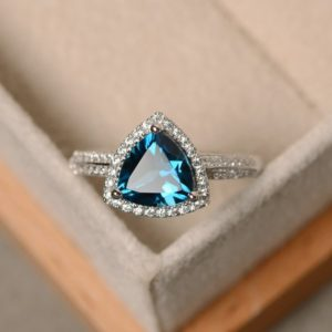 Shop Topaz Jewelry! London blue topaz ring, engagement ring, blue topaz ring, trillion cut ring | Natural genuine gemstone jewelry in modern, chic, boho, elegant styles. Buy crystal handmade handcrafted artisan art jewelry & accessories. #jewelry #beaded #beadedjewelry #product #gifts #shopping #style #fashion #product