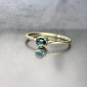 Shop Tourmaline Rings! Indicolite Tourmaline 18K Yellow Gold Ring Stackable Modern Delicate Green-Blue Teal Color Brazilian Gemstone Round Cabochon – Ocean Driblet | Natural genuine Tourmaline rings, simple unique handcrafted gemstone rings. #rings #jewelry #shopping #gift #handmade #fashion #style #affiliate #ad