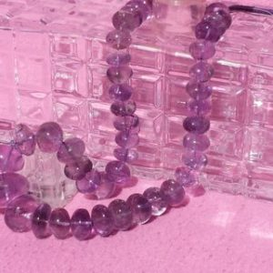 Shop Amethyst Rondelle Beads! Large Amethyst Graduating Smooth Rondelle Beads 18 In. Strand, Natural Purple Amethyst, 15.5mm-29.4mm, 1000cts. | Natural genuine rondelle Amethyst beads for beading and jewelry making.  #jewelry #beads #beadedjewelry #diyjewelry #jewelrymaking #beadstore #beading #affiliate #ad