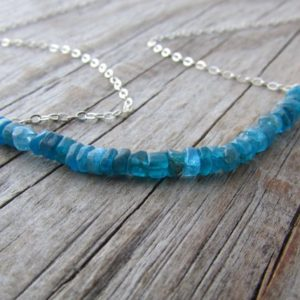 Shop Apatite Necklaces! Apatite Necklace, Tiny Apatite Rondelles, Gemstone Nuggets, Rough Blue Stone Necklace, Swing Necklace, Layering Necklace, Heishi Beads | Natural genuine Apatite necklaces. Buy crystal jewelry, handmade handcrafted artisan jewelry for women.  Unique handmade gift ideas. #jewelry #beadednecklaces #beadedjewelry #gift #shopping #handmadejewelry #fashion #style #product #necklaces #affiliate #ad