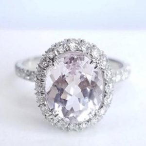 Shop Kunzite Rings! Diamond Halo Kunzite Ring Engagement Ring – Made in The USA | Natural genuine Kunzite rings, simple unique alternative gemstone engagement rings. #rings #jewelry #bridal #wedding #jewelryaccessories #engagementrings #weddingideas #affiliate #ad
