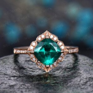 Shop Emerald Engagement Rings! Flower cluster diamond halo ring green emerald engagement ring rose gold cushion emerald ring vintage antique May birthstone wedding ring | Natural genuine Emerald rings, simple unique alternative gemstone engagement rings. #rings #jewelry #bridal #wedding #jewelryaccessories #engagementrings #weddingideas #affiliate #ad