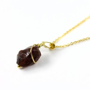 Shop Garnet Jewelry! Rough Garnet Necklace – 14K Gold Filled – Irregular Shape Raw Garnet Stone – Natural Stone Necklace – January Birthday Gift Idea | Natural genuine Garnet jewelry. Buy crystal jewelry, handmade handcrafted artisan jewelry for women.  Unique handmade gift ideas. #jewelry #beadedjewelry #beadedjewelry #gift #shopping #handmadejewelry #fashion #style #product #jewelry #affiliate #ad