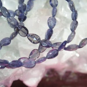 Natural Iolite Long-Drilled Faceted Flat Drop Beads 8 In. Strand, Iolite Faceted Drop Beads, Water Sapphire, Blue Iolite | Natural genuine other-shape Iolite beads for beading and jewelry making.  #jewelry #beads #beadedjewelry #diyjewelry #jewelrymaking #beadstore #beading #affiliate #ad