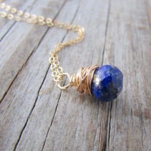 Shop Lapis Lazuli Pendants! Lapis Necklace, small, minimalist, gold, wire wrapped, faceted lapis pendant | Natural genuine Lapis Lazuli pendants. Buy crystal jewelry, handmade handcrafted artisan jewelry for women.  Unique handmade gift ideas. #jewelry #beadedpendants #beadedjewelry #gift #shopping #handmadejewelry #fashion #style #product #pendants #affiliate #ad