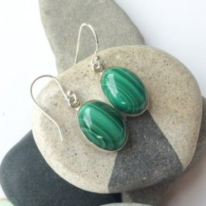 Shop Malachite Earrings! Malachite earrings, Large oval sterling silver Malachite earrings, Green gem earrings, Natural Malachite, Dangle earrings, Big gem earrings | Natural genuine Malachite earrings. Buy crystal jewelry, handmade handcrafted artisan jewelry for women.  Unique handmade gift ideas. #jewelry #beadedearrings #beadedjewelry #gift #shopping #handmadejewelry #fashion #style #product #earrings #affiliate #ad