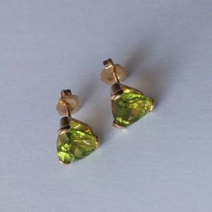 Shop Peridot Earrings! 14k gold natural peridot earrings trillion green solitaire studs 7 mm yellow gold vintage jewelry gift | Natural genuine Peridot earrings. Buy crystal jewelry, handmade handcrafted artisan jewelry for women.  Unique handmade gift ideas. #jewelry #beadedearrings #beadedjewelry #gift #shopping #handmadejewelry #fashion #style #product #earrings #affiliate #ad