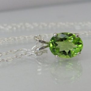 Peridot Pendant In Sterling Silver, 9x7mm Natural Peridot, August Birthstone | Natural genuine Peridot pendants. Buy crystal jewelry, handmade handcrafted artisan jewelry for women.  Unique handmade gift ideas. #jewelry #beadedpendants #beadedjewelry #gift #shopping #handmadejewelry #fashion #style #product #pendants #affiliate #ad