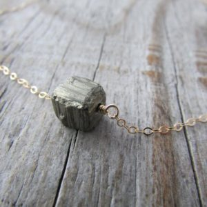 Shop Pyrite Necklaces! Raw Pyrite Necklace, small cube of pyrite on a gold chain, minimalist necklace, cube necklace, choker | Natural genuine Pyrite necklaces. Buy crystal jewelry, handmade handcrafted artisan jewelry for women.  Unique handmade gift ideas. #jewelry #beadednecklaces #beadedjewelry #gift #shopping #handmadejewelry #fashion #style #product #necklaces #affiliate #ad