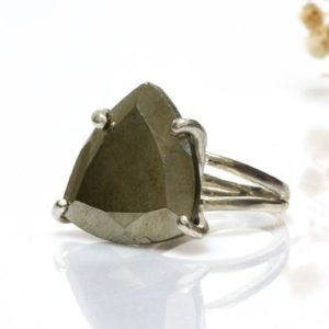 Shop Pyrite Jewelry! Pyrite Ring · Silver Ring · Gemstone Ring · Trillion Ring · Triangle Ring · Large Stone Ring · Statement Ring · Iron Pyrite Ring | Natural genuine Pyrite jewelry. Buy crystal jewelry, handmade handcrafted artisan jewelry for women.  Unique handmade gift ideas. #jewelry #beadedjewelry #beadedjewelry #gift #shopping #handmadejewelry #fashion #style #product #jewelry #affiliate #ad