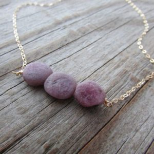 Shop Ruby Necklaces! Raw Ruby Necklace, unpolished, rough tumbled gemstone and gold necklace | Natural genuine Ruby necklaces. Buy crystal jewelry, handmade handcrafted artisan jewelry for women.  Unique handmade gift ideas. #jewelry #beadednecklaces #beadedjewelry #gift #shopping #handmadejewelry #fashion #style #product #necklaces #affiliate #ad
