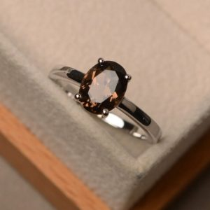 Shop Smoky Quartz Rings! Smoky quartz ring, solitaire ring, oval shape ring, engagement ring for women | Natural genuine Smoky Quartz rings, simple unique alternative gemstone engagement rings. #rings #jewelry #bridal #wedding #jewelryaccessories #engagementrings #weddingideas #affiliate #ad