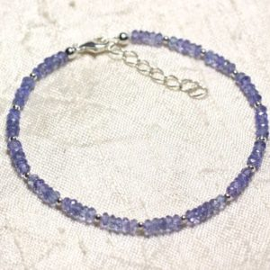 Shop Tanzanite Bracelets! 925 Sterling Silver And Stone – Tanzanite Faceted 3x2mm Rondelle Bracelet | Natural genuine Tanzanite bracelets. Buy crystal jewelry, handmade handcrafted artisan jewelry for women.  Unique handmade gift ideas. #jewelry #beadedbracelets #beadedjewelry #gift #shopping #handmadejewelry #fashion #style #product #bracelets #affiliate #ad