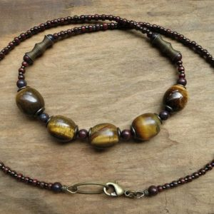 Shop Tiger Eye Necklaces! Rustic Tiger's Eye Necklace, Golden Brown And Dark Red Beaded Tigers Eye Stone Pebble Bohemian Jewelry | Natural genuine Tiger Eye necklaces. Buy crystal jewelry, handmade handcrafted artisan jewelry for women.  Unique handmade gift ideas. #jewelry #beadednecklaces #beadedjewelry #gift #shopping #handmadejewelry #fashion #style #product #necklaces #affiliate #ad