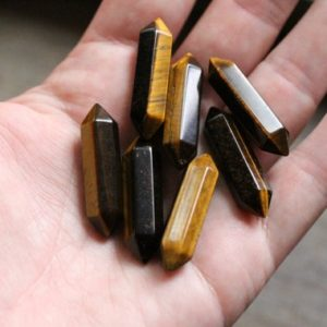 Shop Tiger Eye Stones & Crystals! Tiger Eye Double Terminated Carved Point J81 | Natural genuine stones & crystals in various shapes & sizes. Buy raw cut, tumbled, or polished gemstones for making jewelry or crystal healing energy vibration raising reiki stones. #crystals #gemstones #crystalhealing #crystalsandgemstones #energyhealing #affiliate #ad