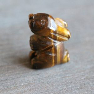 Shop Tiger Eye Shapes! Tiger Eye Bunny Rabbit Figurine F355 | Natural genuine stones & crystals in various shapes & sizes. Buy raw cut, tumbled, or polished gemstones for making jewelry or crystal healing energy vibration raising reiki stones. #crystals #gemstones #crystalhealing #crystalsandgemstones #energyhealing #affiliate #ad