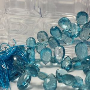 Shop Topaz Bead Shapes! Gorgeous London Blue Topaz Graduating Faceted Flat Drop Beads 8 In. Full Strand, 116cts. Pear Shape Briolettes, Semiprecious Gemstones Beads | Natural genuine other-shape Topaz beads for beading and jewelry making.  #jewelry #beads #beadedjewelry #diyjewelry #jewelrymaking #beadstore #beading #affiliate #ad
