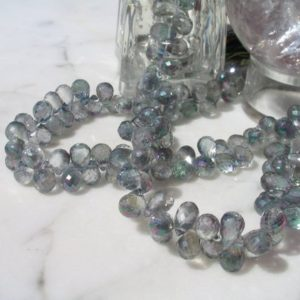 Shop Topaz Bead Shapes! Mystic Rainbow Topaz Micro Faceted Drop Beads 7 In. Strand, 120cts. Faceted Pear Shape, Designer Quality, Micro Faceted Teardrop Shape | Natural genuine other-shape Topaz beads for beading and jewelry making.  #jewelry #beads #beadedjewelry #diyjewelry #jewelrymaking #beadstore #beading #affiliate #ad