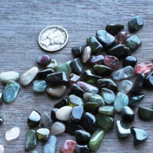 Shop Tumbled Tourmaline Crystals & Pocket Stones! Tiny Tourmaline Tumbled Stone T34 | Natural genuine stones & crystals in various shapes & sizes. Buy raw cut, tumbled, or polished gemstones for making jewelry or crystal healing energy vibration raising reiki stones. #crystals #gemstones #crystalhealing #crystalsandgemstones #energyhealing #affiliate #ad