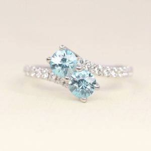 Shop Zircon Rings! Blue Zircon Engagement Ring.Diamond Engagement Ring.December Birthstone Ring.Unique Diamond Ring.Unique Engagement Ring.Diamond Wedding Ring | Natural genuine Zircon rings, simple unique alternative gemstone engagement rings. #rings #jewelry #bridal #wedding #jewelryaccessories #engagementrings #weddingideas #affiliate #ad