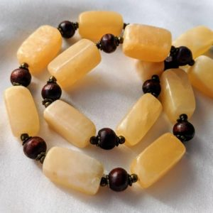 Chunky, handmade necklace with alabaster calcite, wood, & gold beads. Cream, golden, and sunny yellow luminous stones. Long boho jewelry | Natural genuine Calcite necklaces. Buy crystal jewelry, handmade handcrafted artisan jewelry for women.  Unique handmade gift ideas. #jewelry #beadednecklaces #beadedjewelry #gift #shopping #handmadejewelry #fashion #style #product #necklaces #affiliate #ad