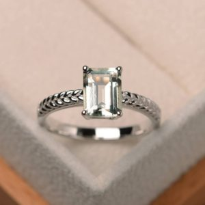 Shop Green Amethyst Rings! Natural green amethyst ring, wedding ring, emerald cut green gemstone, solitaire ring, sterling silver ring | Natural genuine Green Amethyst rings, simple unique alternative gemstone engagement rings. #rings #jewelry #bridal #wedding #jewelryaccessories #engagementrings #weddingideas #affiliate #ad