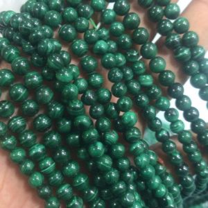 Shop Malachite Round Beads! Natural Malachite round 6mm beads, Natural Malachite beads 15 inch strand | Natural genuine round Malachite beads for beading and jewelry making.  #jewelry #beads #beadedjewelry #diyjewelry #jewelrymaking #beadstore #beading #affiliate #ad