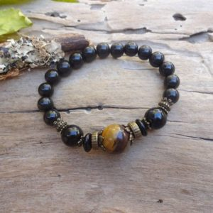Black Jet Stone Petrified wood stretch bracelet / Lignite Gagat protection bracelet Healing bracelets Men gift under 30 dollars | Natural genuine Petrified Wood bracelets. Buy crystal jewelry, handmade handcrafted artisan jewelry for women.  Unique handmade gift ideas. #jewelry #beadedbracelets #beadedjewelry #gift #shopping #handmadejewelry #fashion #style #product #bracelets #affiliate #ad