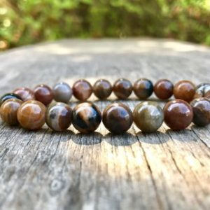Fossil Wood Bracelet Handmade 8mm Petrified Wood Beaded Bracelet Stack Bracelet Unisex Bracelet Gift Bracelet | Natural genuine Petrified Wood bracelets. Buy crystal jewelry, handmade handcrafted artisan jewelry for women.  Unique handmade gift ideas. #jewelry #beadedbracelets #beadedjewelry #gift #shopping #handmadejewelry #fashion #style #product #bracelets #affiliate #ad