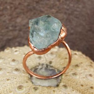 Shop Fluorite Rings! Raw Fluorite Ring | Rough Fluorite Copper Ring | Pale Green Fluorite Ring | Natural genuine Fluorite rings, simple unique handcrafted gemstone rings. #rings #jewelry #shopping #gift #handmade #fashion #style #affiliate #ad