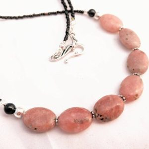 Shop Rhodonite Necklaces! Simple Rhodonite Oval Necklace. Natural Pink Gemstone Jewelry. Long Length, Great For Layering. Silver Plate Accents. Millennial Pink Shades | Natural genuine Rhodonite necklaces. Buy crystal jewelry, handmade handcrafted artisan jewelry for women.  Unique handmade gift ideas. #jewelry #beadednecklaces #beadedjewelry #gift #shopping #handmadejewelry #fashion #style #product #necklaces #affiliate #ad
