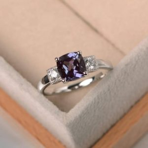 lab alexandrite ring , engagement ring, cushion cut, silver ring, June birthstone ring,color changing gemstone ring | Natural genuine Gemstone rings, simple unique alternative gemstone engagement rings. #rings #jewelry #bridal #wedding #jewelryaccessories #engagementrings #weddingideas #affiliate #ad