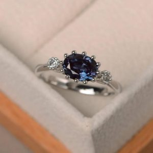 Shop Alexandrite Rings! Three stones ring, lab alexandrite ring, engagement ring, color changing gemstone, June birthstone, oval cut gemstone | Natural genuine Alexandrite rings, simple unique alternative gemstone engagement rings. #rings #jewelry #bridal #wedding #jewelryaccessories #engagementrings #weddingideas #affiliate #ad