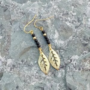 Shop Black Tourmaline Earrings! Black Tourmaline earrings with gold leaf drops for women, healing stone jewelry, protective stone earrings, leaf jewelry, free shipping | Natural genuine Black Tourmaline earrings. Buy crystal jewelry, handmade handcrafted artisan jewelry for women.  Unique handmade gift ideas. #jewelry #beadedearrings #beadedjewelry #gift #shopping #handmadejewelry #fashion #style #product #earrings #affiliate #ad