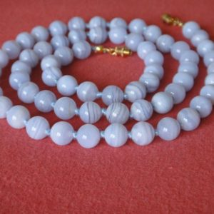 Shop Blue Lace Agate Jewelry! Blue Lace Agate Necklace. Genuine Stone. 8mm Round Beads. 25 inches long. Hand Knotted. Grade 'A' Therapeutic Necklace. MapenziGems | Natural genuine Blue Lace Agate jewelry. Buy crystal jewelry, handmade handcrafted artisan jewelry for women.  Unique handmade gift ideas. #jewelry #beadedjewelry #beadedjewelry #gift #shopping #handmadejewelry #fashion #style #product #jewelry #affiliate #ad