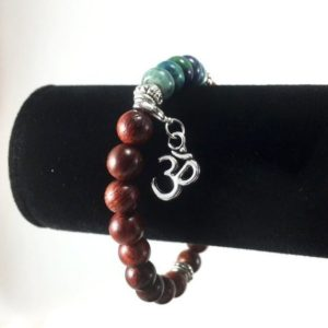 Shop Chrysocolla Bracelets! Rosewood, Chrysocolla And Om Charm Bracelet / Natural Rosewood / Chrysocolla / Gemstone / Om / Charm / Bracelet / Yoga / Mala / Spiritual / Jewelry | Natural genuine Chrysocolla bracelets. Buy crystal jewelry, handmade handcrafted artisan jewelry for women.  Unique handmade gift ideas. #jewelry #beadedbracelets #beadedjewelry #gift #shopping #handmadejewelry #fashion #style #product #bracelets #affiliate #ad