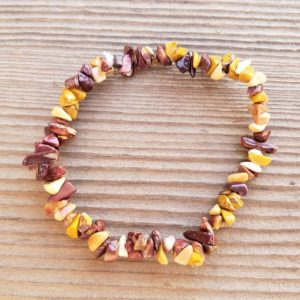 Shop Mookaite Bracelets! MOOKAITE JASPER Natural Stone Gemstone Stretchy Chip Bracelet | Natural genuine Mookaite bracelets. Buy crystal jewelry, handmade handcrafted artisan jewelry for women.  Unique handmade gift ideas. #jewelry #beadedbracelets #beadedjewelry #gift #shopping #handmadejewelry #fashion #style #product #bracelets #affiliate #ad