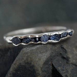 Raw Blue Sapphire Ring. Blue Sapphire Ring. Blue Sapphire Engagement Ring. Blue Sapphire Band. Blue Sapphire Wedding Band | Natural genuine Array rings, simple unique alternative gemstone engagement rings. #rings #jewelry #bridal #wedding #jewelryaccessories #engagementrings #weddingideas #affiliate #ad