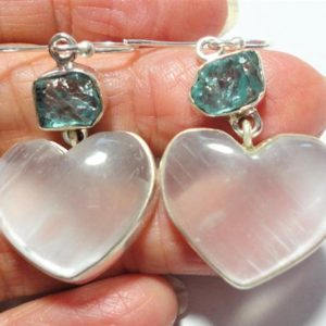 Shop Heart Shaped Earrings! Selenite Earrings Silky White Selenite Heart Gemstone Earrings with Genuine Neon Blue Apatite Nuggets  in Solid Sterling | Natural genuine Gemstone earrings. Buy crystal jewelry, handmade handcrafted artisan jewelry for women.  Unique handmade gift ideas. #jewelry #beadedearrings #beadedjewelry #gift #shopping #handmadejewelry #fashion #style #product #earrings #affiliate #ad