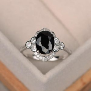 Shop Spinel Rings! Oval black spinel ring, black rings, black gemstone ring, engagement ring, sterling silver | Natural genuine Spinel rings, simple unique alternative gemstone engagement rings. #rings #jewelry #bridal #wedding #jewelryaccessories #engagementrings #weddingideas #affiliate #ad