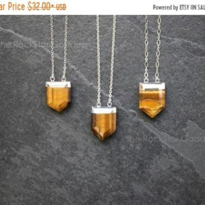 Tigers Eye Necklace / Tiger Eye Pendant / Tiger Eye / Brown Tiger's Eye / Tiger Eye Jewelry | Natural genuine Tiger Eye pendants. Buy crystal jewelry, handmade handcrafted artisan jewelry for women.  Unique handmade gift ideas. #jewelry #beadedpendants #beadedjewelry #gift #shopping #handmadejewelry #fashion #style #product #pendants #affiliate #ad