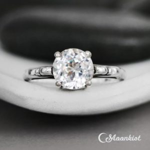 White Sapphire Engagement Ring, Vintage-Style Scroll Wedding Ring, Sterling Silver Filigree Ring, Diamond Alternative | Moonkist Designs | Natural genuine Sapphire jewelry. Buy handcrafted artisan wedding jewelry.  Unique handmade bridal jewelry gift ideas. #jewelry #beadedjewelry #gift #crystaljewelry #shopping #handmadejewelry #wedding #bridal #jewelry #affiliate #ad