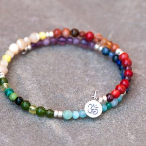 Shop Chakra Bracelets! Yoga Bangle, Chakra Bracelet, Silver Om Charm, Rainbow Bangle, Natural Stone, MultiColor Memory Wire, Zen Bracelet Chakra Color, Ohm Charm | Shop jewelry making and beading supplies, tools & findings for DIY jewelry making and crafts. #jewelrymaking #diyjewelry #jewelrycrafts #jewelrysupplies #beading #affiliate #ad