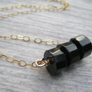 Shop Black Tourmaline Necklaces! Faceted Black Tourmaline Necklace, 14K Golf Filled Bar Necklace, Faceted Tube Gemstones, Jet Black Floating Pendant | Natural genuine Black Tourmaline necklaces. Buy crystal jewelry, handmade handcrafted artisan jewelry for women.  Unique handmade gift ideas. #jewelry #beadednecklaces #beadedjewelry #gift #shopping #handmadejewelry #fashion #style #product #necklaces #affiliate #ad