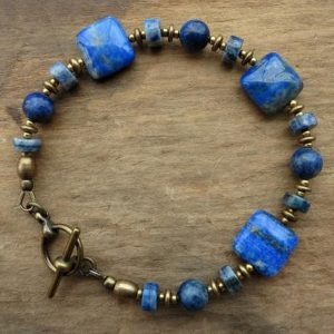 Shop Lapis Lazuli Bracelets! Lapis Lazuli Bracelet, blue and gold Bohemian beaded bracelet with cobalt blue stones and golden brass | Natural genuine Lapis Lazuli bracelets. Buy crystal jewelry, handmade handcrafted artisan jewelry for women.  Unique handmade gift ideas. #jewelry #beadedbracelets #beadedjewelry #gift #shopping #handmadejewelry #fashion #style #product #bracelets #affiliate #ad