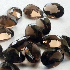 Shop Smoky Quartz Cabochons! Smoky Quartz Cut Stone Lot – Oval Faceted Calibrated Smoky Quartz – 14x10mm Each  – 15 Pieces, 77.60 Carats, Beautiful  Brown Cabochon Lot | Natural genuine stones & crystals in various shapes & sizes. Buy raw cut, tumbled, or polished gemstones for making jewelry or crystal healing energy vibration raising reiki stones. #crystals #gemstones #crystalhealing #crystalsandgemstones #energyhealing #affiliate #ad