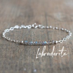 Shop Labradorite Bracelets! Dainty Labradorite Crystal Bracelets for Women, Rose Gold or Sterling Silver | Natural genuine Labradorite bracelets. Buy crystal jewelry, handmade handcrafted artisan jewelry for women.  Unique handmade gift ideas. #jewelry #beadedbracelets #beadedjewelry #gift #shopping #handmadejewelry #fashion #style #product #bracelets #affiliate #ad