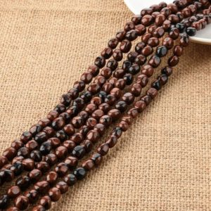Shop Mahogany Obsidian Beads! One Strand Natural Mahogany Obsidian Barrel Nugget Beads 9mm | Natural genuine chip Mahogany Obsidian beads for beading and jewelry making.  #jewelry #beads #beadedjewelry #diyjewelry #jewelrymaking #beadstore #beading #affiliate #ad